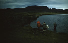 Photograph of a group of people walking by a lake near Cape Dorset, Northwest Territories