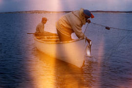 Photograph of two men fishing in a canoe in Fort Chimo, Quebec