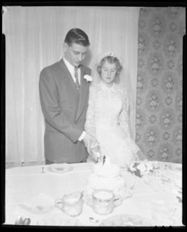 Photograph of Marilyn MacPherson and her husband cutting the wedding cake