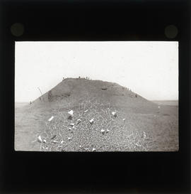Photograph of a group of people on a hill