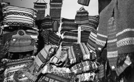 Photograph of a stand selling woven items at a craft market