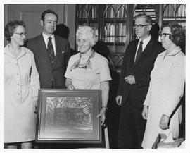 Photograph of the presentation of a picture to Mrs. Stoker