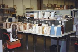 Photograph of damaged books drying on a table