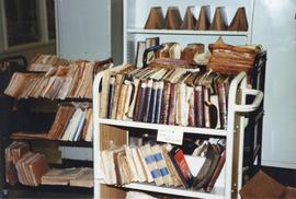 Photograph of a cart full of damaged books