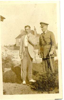 Photograph of T.H. Raddall, Sr. in uniform while on leave in England with a gentleman in plainclo...