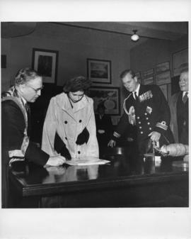 Photograph of Dr. Kerr, Princess Elizabeth, the Duke of Edinburgh, and Colonel Laurie
