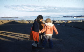 Photograph of three children playing in in Frobisher Bay, Northwest Territories