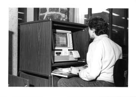Photograph of a woman using a computer in the Killam Memorial Library