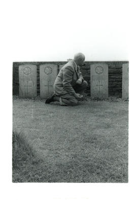 Photograph of Thomas Head Raddall at his father's grave in the Manitoba Cemetery, Amiens Battlefi...