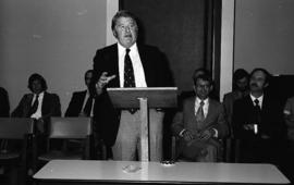 Photograph of an unidentified person speaking at the law school opening