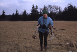 Photograph of Barbara Hinds carrying a bundle of sticks