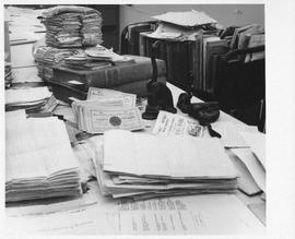 Photograph of piles of documents in the Dalhousie University Archives