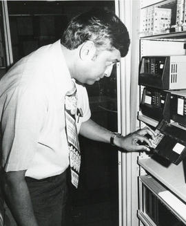 Photograph of Dalhousie Computer Centre Director Intab Ali with equipment
