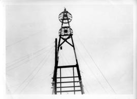 Photograph of the top of a triangle microwave tower