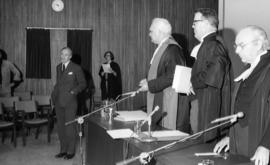 Photograph of unidentified people at a law award presentation