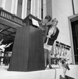 Photograph of an podium in front of the Tupper Building