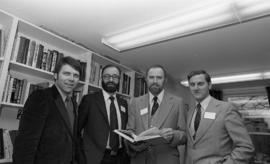 Photograph of four unidentified people at the opening of the Ocean Studies house