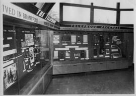 Photograph of a telephone display behind glass