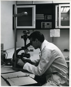 Photograph of D. A. Gibson with microscope