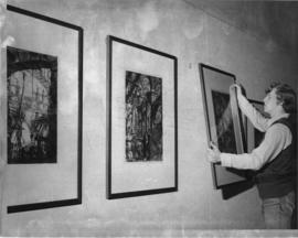 Photograph of Stephen Gertridge hanging art