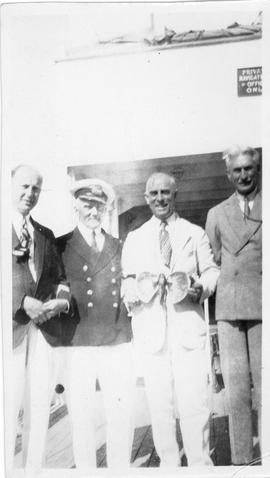 Photograph of Arthur Stanley MacKenzie and three unidentified people on a cruise ship