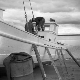 Photograph of a boat called the Joan Ryan sitting on the shore in Fort Chimo, Quebec