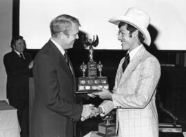 Photograph of Pierre Page and Guy R. MacLean : Coach of the Year award presentation