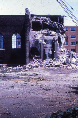 Photograph of demolition of Medical-Dental Library, broken wall