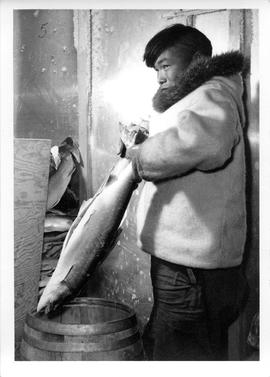 Photograph of an unidentified man holding a fish