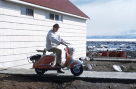 Photograph of Barbara Hinds on a scooter in Frobisher Bay, Northwest Territories