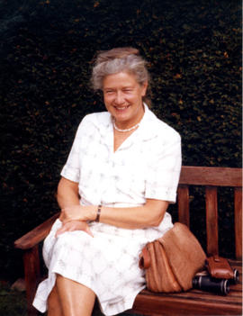 Photograph of Barbara Hinds sitting on a bench