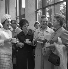 Photograph of four unidentified people with teacups