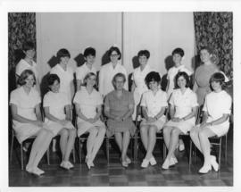 Photograph and photopgraphic negative of the first graduates of the Bachelor of Nursing Program