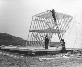 Photograph of the construction of an A-frame building for research and dwelling on Sable Island
