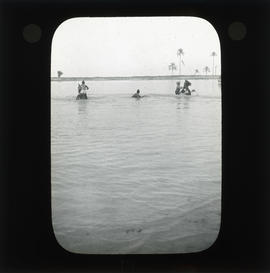Photograph of unidentified soldiers on horseback in water