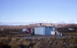 Photograph of two small buildings on the tundra in northern Quebec