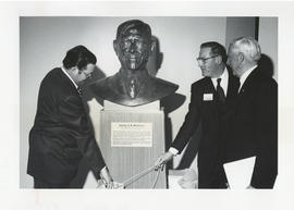 Photograph of James L. Denholme, Donovan F. Miller, and Norman A. M. MacKenzie unveiling a bust