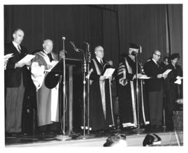 Photograph of A. E. Kerr, Lady Dunn, and others on stage