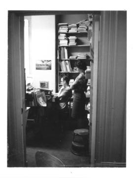 Photograph of Ruth Cordy and Anita Watson in the Cataloging Office of the 5963 College Street bui...