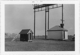 Photograph of a tower and a hut at Egmont Bay, Prince Edward Island