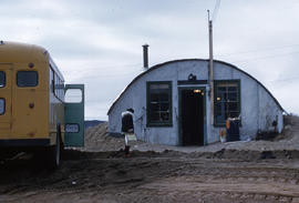 Photograph of a bus and a small building in Frobisher Bay, Northwest Territories