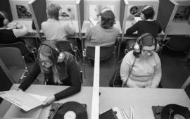 Photograph of a students listening to records and tapes