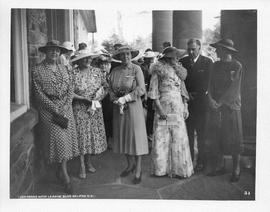 Photograph of Mrs. J. MacG. Stewart, Mrs. Johnstone, and others in front of Shirreff Hall