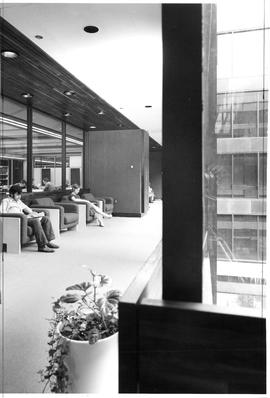 Photograph of a hallway with arm chairs in the Killam Memorial Library