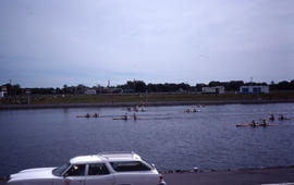 Photograph of a boat race with eight teams visible