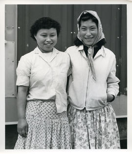 Portrait of two young women with curled hair in Sugluk, Quebec