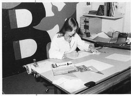Photograph of Bev Cunningham preparing charts