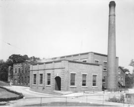 Photograph of a building and a smokestack at the Nova Scotia Technical College