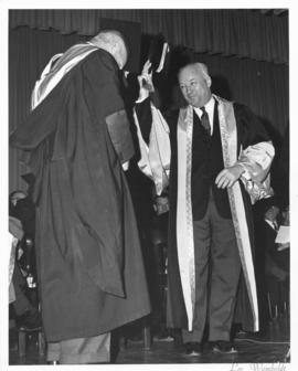 Photograph of Henry Hicks conferring a degree on an unidentified person