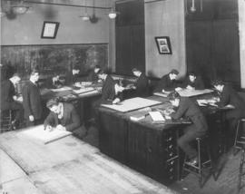 Photograph of a machine drawing class